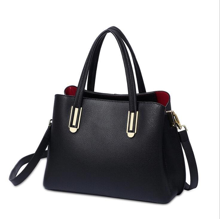 الجلود حقيبة الإناث 2020 النسخة الكورية من جديد من رسول الأزياء حقيبة يد السيدات الأولى طبقة جلد البقر في منتصف العمر حقيبة الأم