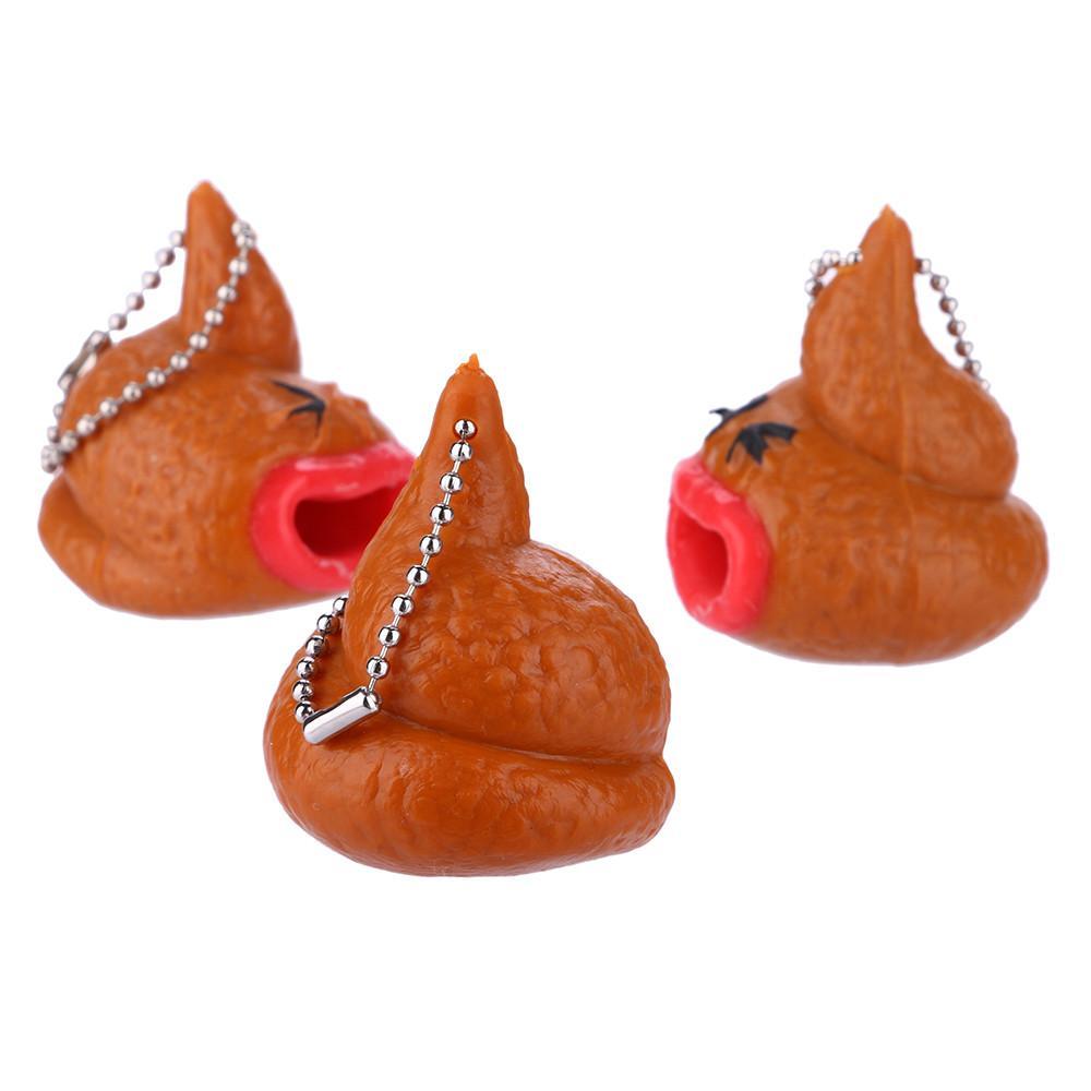 Spremitura soffice Poo Emoticon Toy Portachiavi Pop Out Tongues novità Fun po 'difficile Prank regalo divertente Z0328