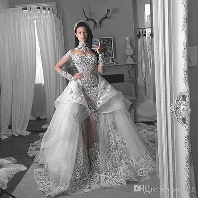 Luxury Sparkly 2020 Mermaid Wedding Dresses Long Sleeve Sexy High Neck Bling Bling Beaded Lace Appliqued Chapel Bridal Gowns Dubai