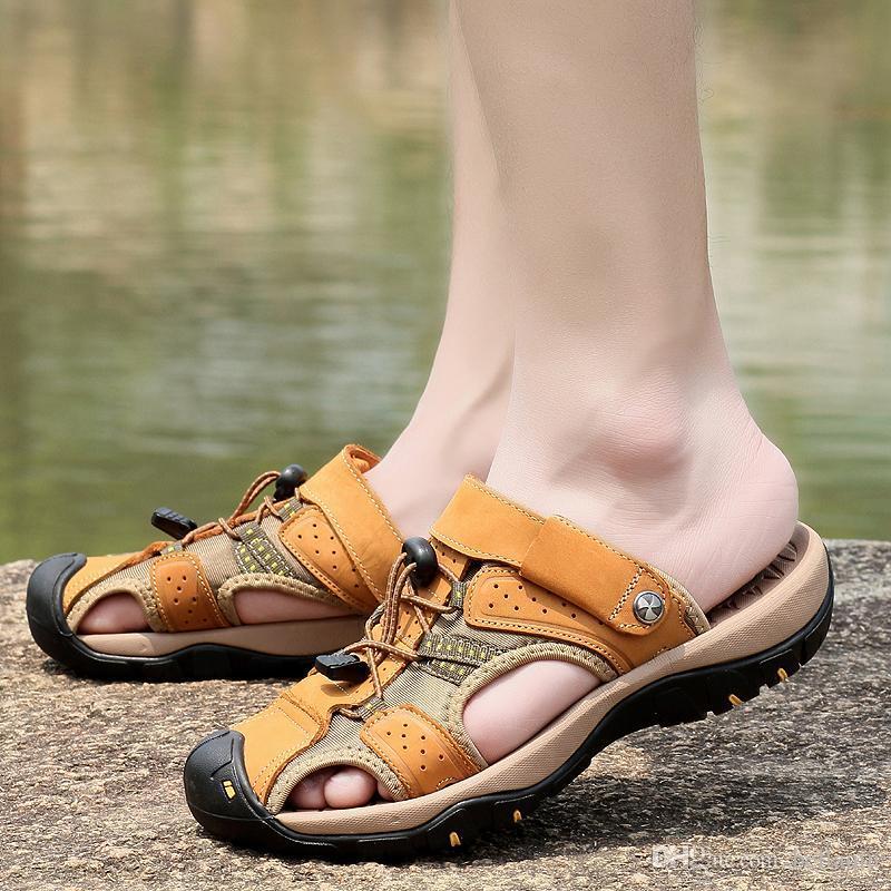 Top-Qualität Echtes Leder Designer-Freizeitschuhe Luxus Slide breite flache Slippery Sommer-Strand-Sandelholz-Paket Zehen Atem Slipper Flip Flop