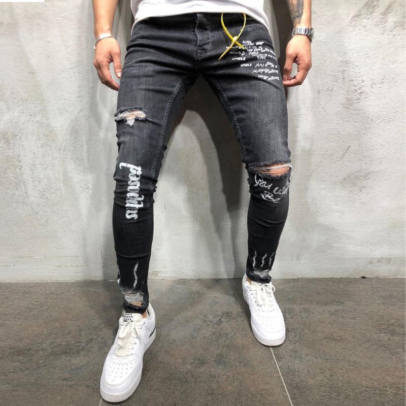 ropa de hombre 2019 Agujeros Negro Nueva elástica del pie de los hombres de Imprimir Carta de las bragas de la manera de ajuste pantalones vaqueros delgados de la mezclilla homme regulares # 5N16 # F