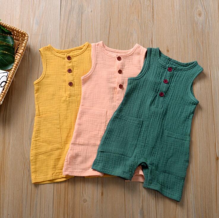 Kids Designer vestiti del bambino Big Pocket pagliaccetti Button Infant cotone delle tute del bambino Estate Solid colletto tondo Body neonato Onesies PY598