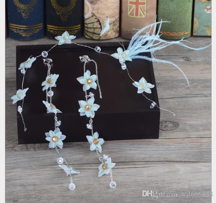 Abalorios azules hechos a mano con plumas, flores, adornos para el pelo, tocados de novia, vestidos y accesorios
