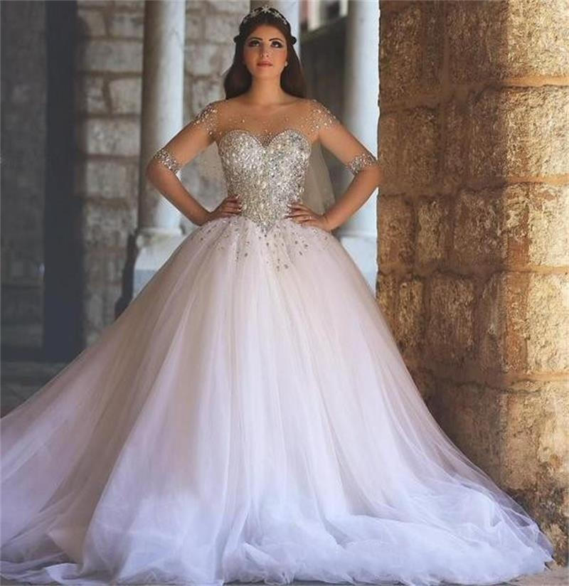 2020 Luxury Ball Gown Illusion Tulle Long Sleeves Wedding Dresses Sheer Neck Beaded Crystals Puffy Vintage Plus Size Bridal Gowns