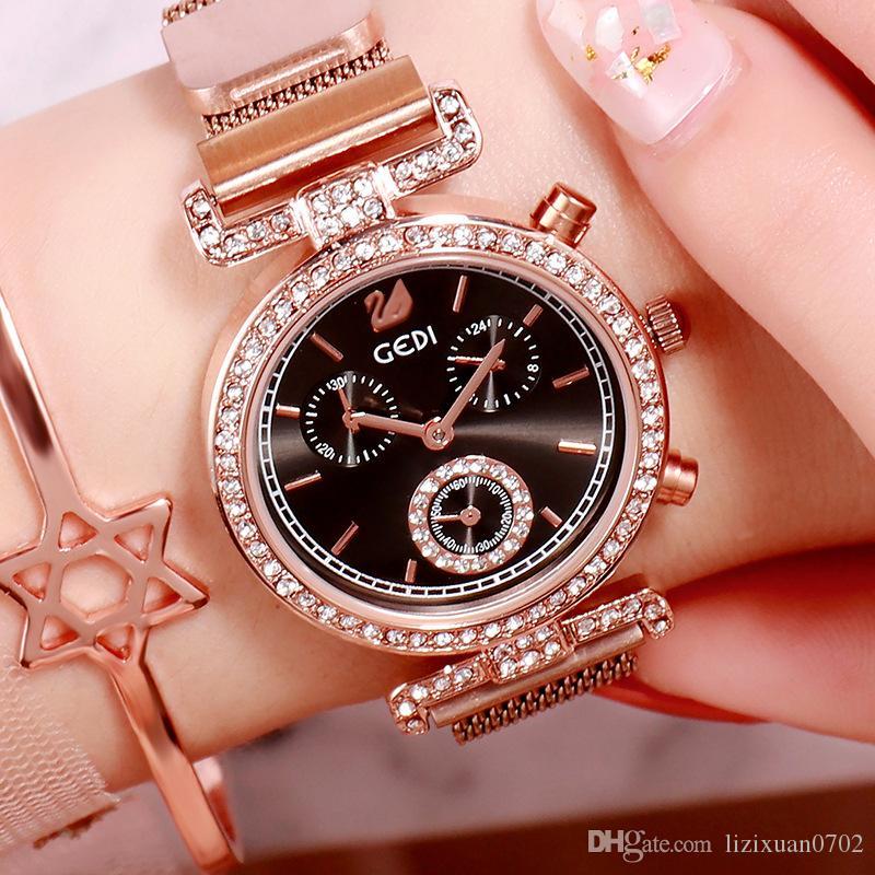 Modelos de explosión de diamante de alto grado de malla magnética informal con mesa flojo manera del temperamento de lujo versátil de cuarzo resistente al agua el reloj femenino