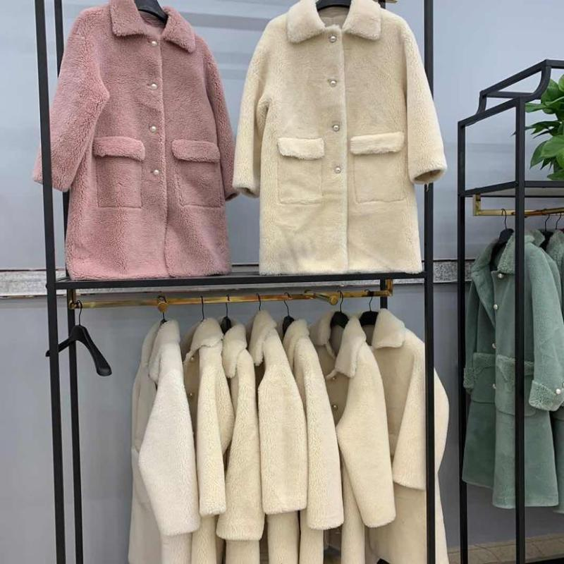 Anti-temporada nova partícula casaco de lã de pele de manga comprida de lã cashmere partícula de comprimento médio casaco de moda feminina
