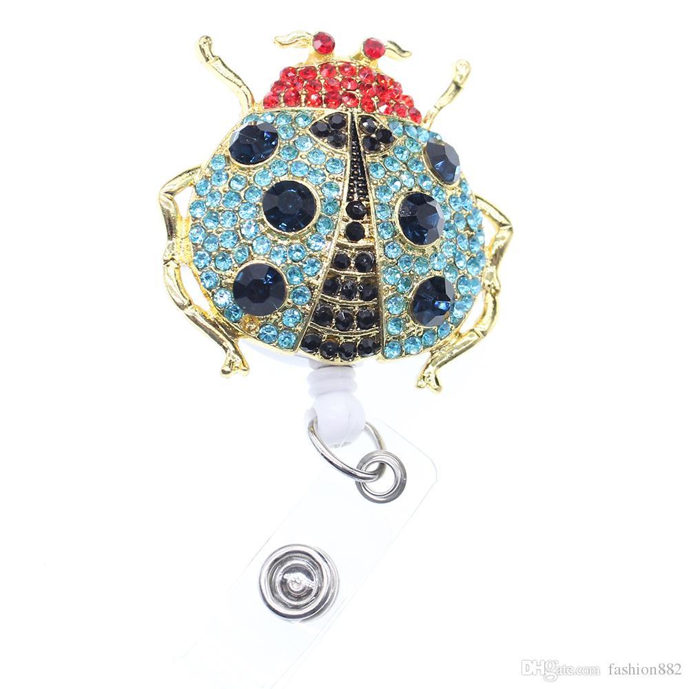 Titolare 50PCS / Lot Rhinesotne Animale Insetto Coccinella ID Badge Reel con clip Yoyo smalto blu bobina retrattile Nome bobina del distintivo