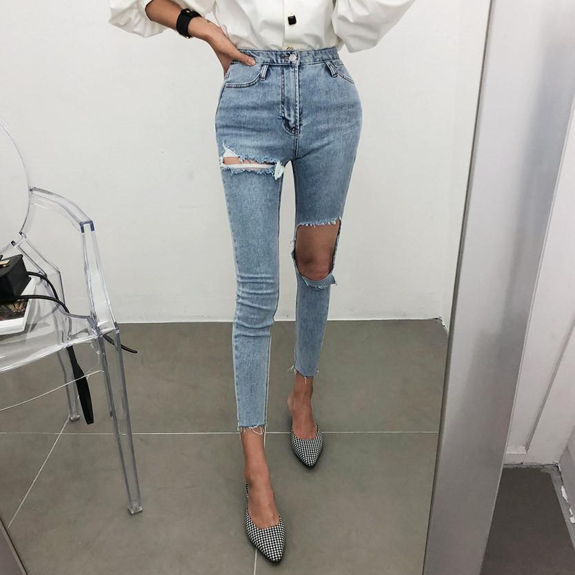 version coréenne de la nouvelle unijambiste grande personnalité trou pantalon amincissant jean taille haute pieds CJ191216
