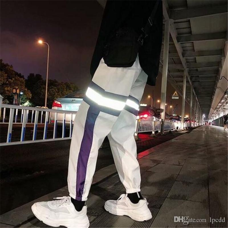 2019 الأزياء عارضة ضوء الليل شريط عاكس البضائع السراويل الرجال ركض ركض السراويل الرجال الهيب هوب زوجين الشارع الشهير بانت pantalones hombre