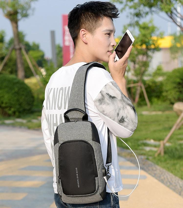 Moda tasarımı erkek çok fonksiyonlu göğüs çantası USB şarj büyük kapasiteli kanvas çanta açık eğlence sırt çantası tablet çanta toptan