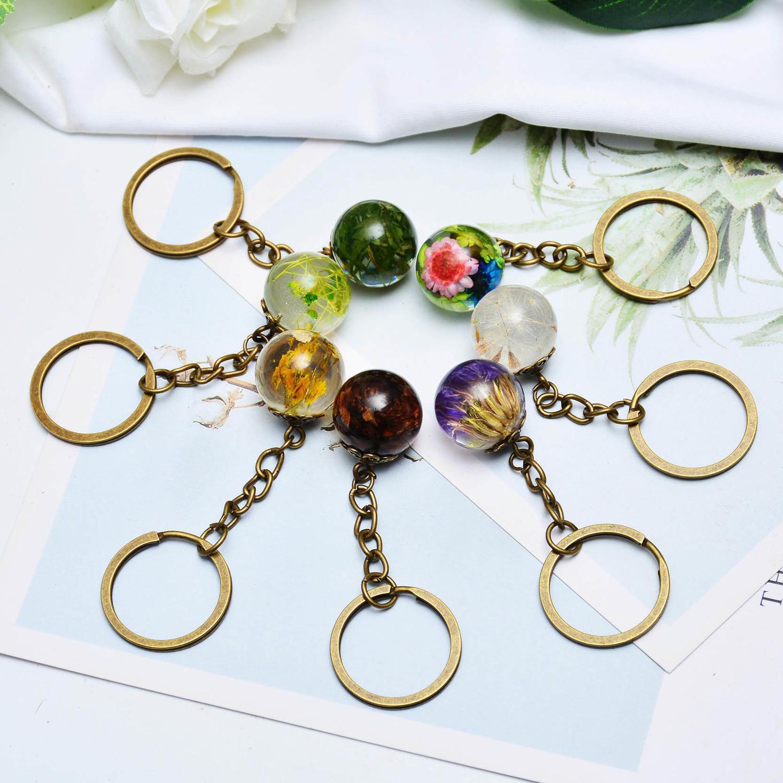 Key Chain nuovo modo creativo naturale essiccato Accessori sacchetto di chiave del Portachiavi pendente della sfera di vetro fiore carino fascino donne della ragazza