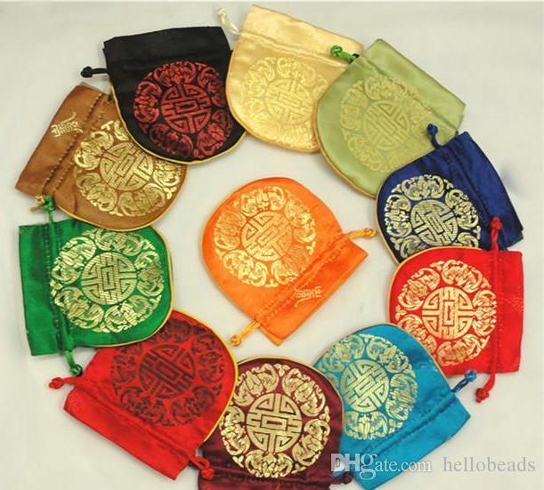 10pcs / lot FOLK عملة محفظة الحقيبة أكياس هدية صغيرة للمجوهرات الحرير حقيبة الحقيبة الصينية أكياس التعبئة بالجملة