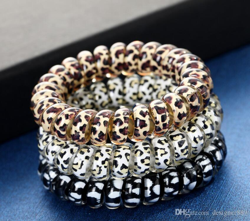 Mulheres menina Telefone Fio cabo Gum bobina Cabelo Gravatas Meninas Bandas elástico de cabelo do anel corda cópia do leopardo Pulseira elásticos de cabelo Ropes 100pcs DHL