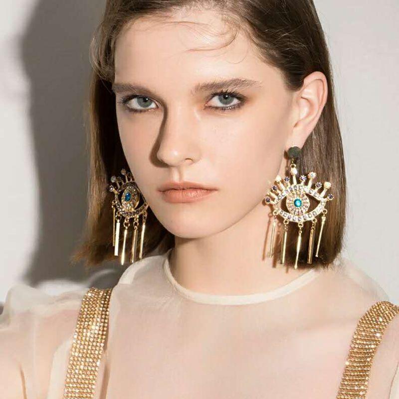 Boucles d'oreilles à la mode Dvacaman des yeux pour les femmes de cristal Boucles d'oreilles en métal long Tassel Hanging Boucles d'oreilles Déclaration de mariage Cadeaux de bijoux