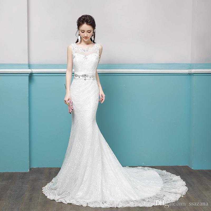 A new bridal gown with floral crystal and lace embellishments beautiful wedding dress Robes De Mariee robes de soirée