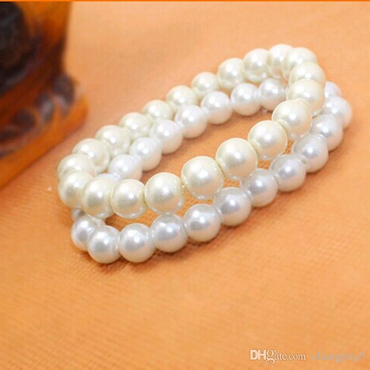 Joyería moldeada manera de las mujeres artificial perlas pulsera brazalete barato blanco puro al por mayor de las perlas de imitación pulsera