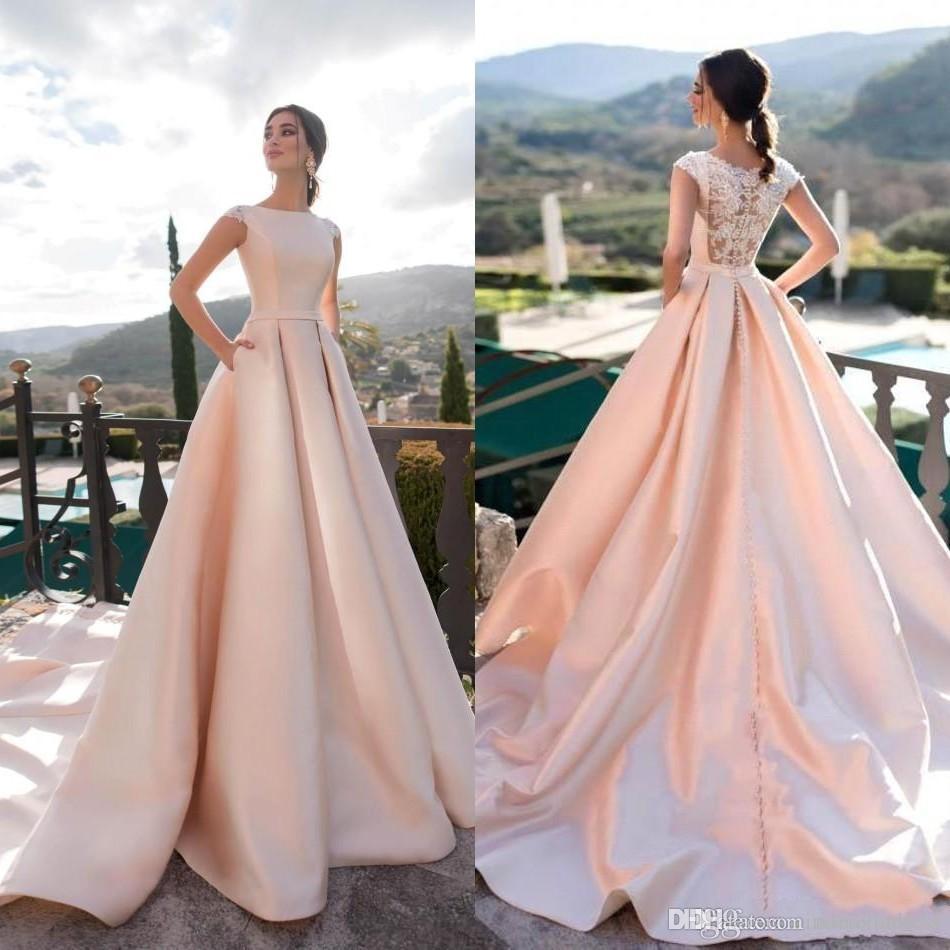 Eleganti abiti da sposa rosa A-Line Collo gioiello Pizzo Satin Abiti da sposa da spiaggia Bottone indietro Sweep Train Abiti da sposa Robe De Mariée