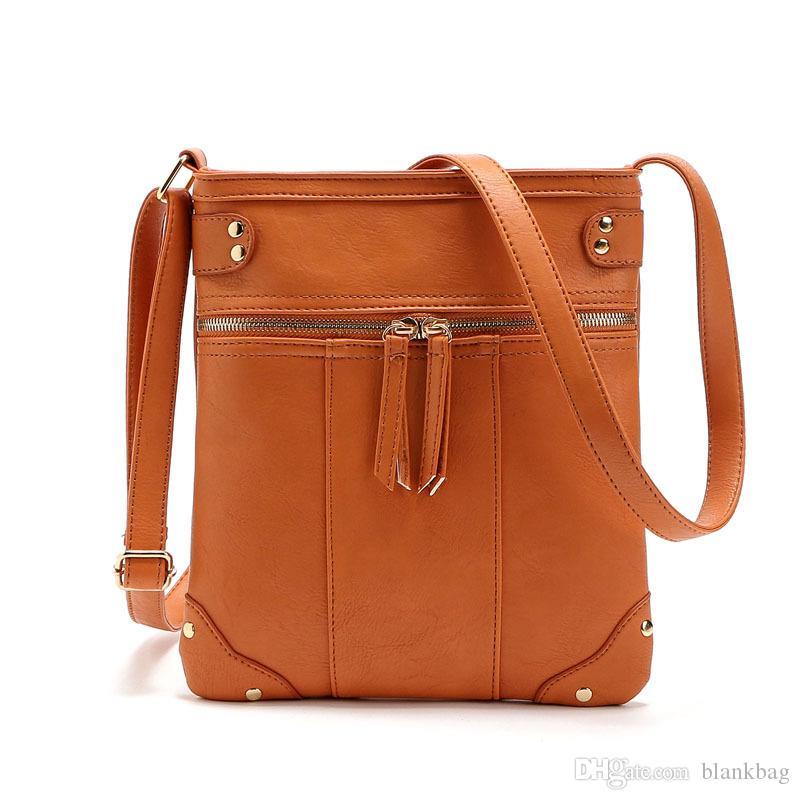 Vintage Haute qualité épaule femmes zipper sac seaux pompon Sac bandoulière en cuir couleur unie simple poignée Messenger Bag