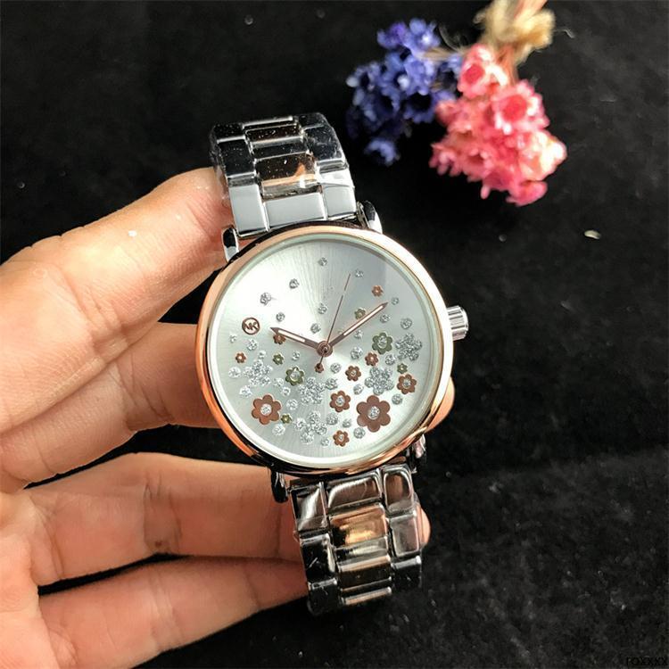roxxxx lujo de las mujeres diseñador de las señoras de cuarzo Broken temblando estilo de línea de flores al por mayor de envío libre de la manera reloj de cuarzo de las mujeres