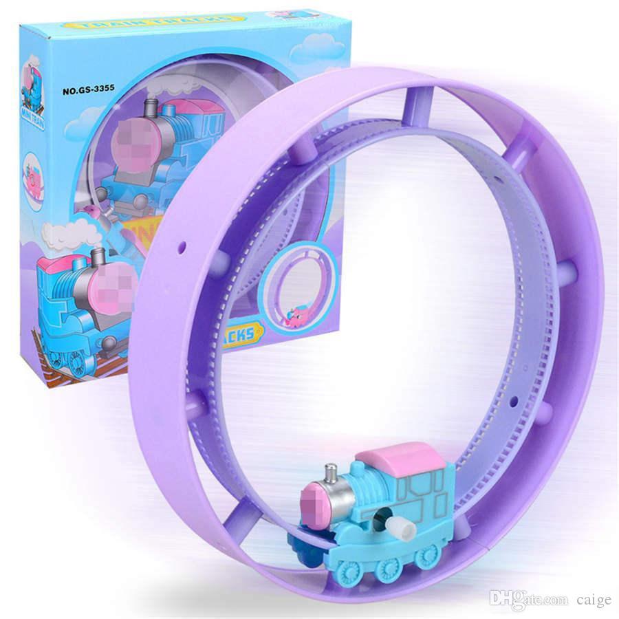 Uhrwerk Kunststoff-Zug-Weihnachts Brain Game Toy Train Uhrwerk Zug Funny Modell Rolling-Circle-Spielzeug Interessante Bildung Spielzeug