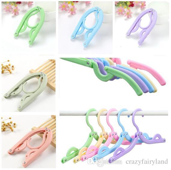 Folding Hangers Travel Plastic Folding Clothes Hanger Portable Multifunction Magic Stretch Clothes Plastic Hangers Storage Hanging Hooks