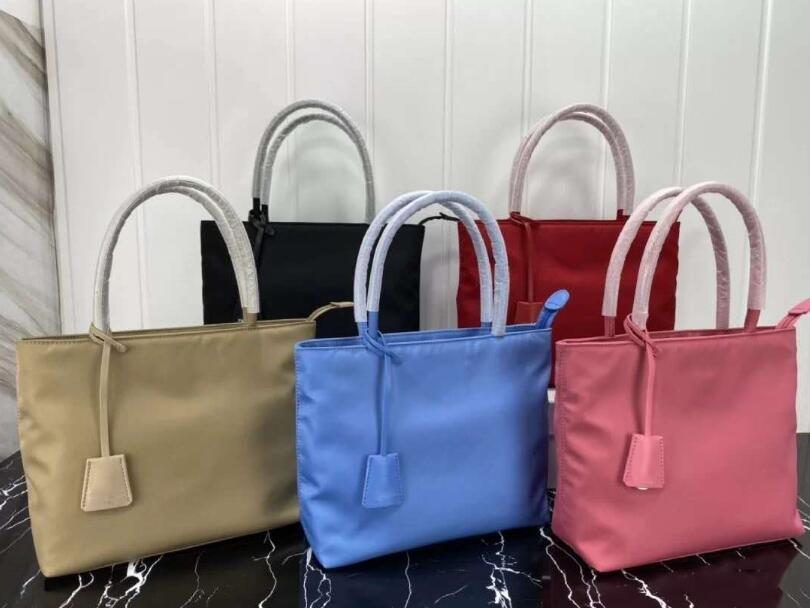 2020 새로운 스타일의 총 컬러 운송 가방 고품질 핸드백 패션 여성 가방 나일론 대용량 여행 가방