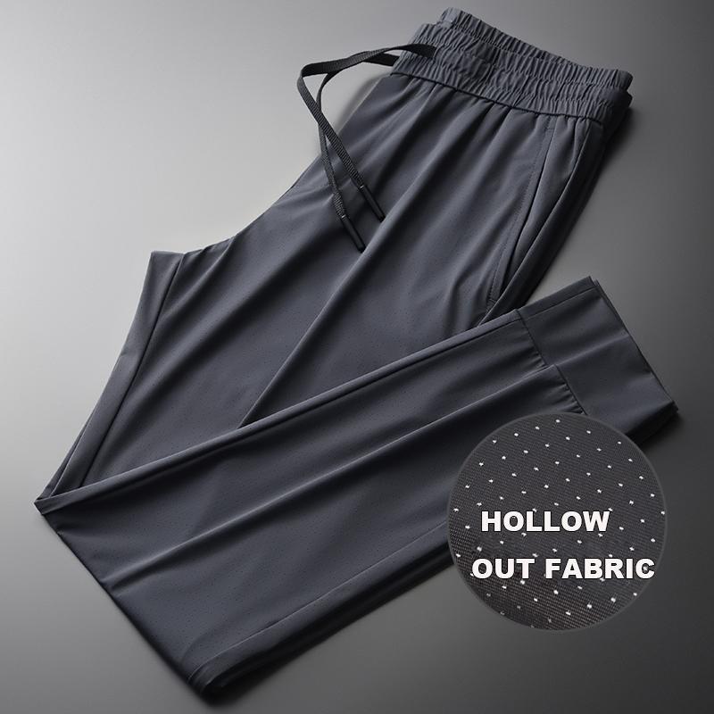 Neue Sommer-graue Herren Pants Luxus aushöhlen Thin-beiläufige Sport-Mann-Hosen plus Größe 4xl Fashion Slim Fit Kordelzug Mann
