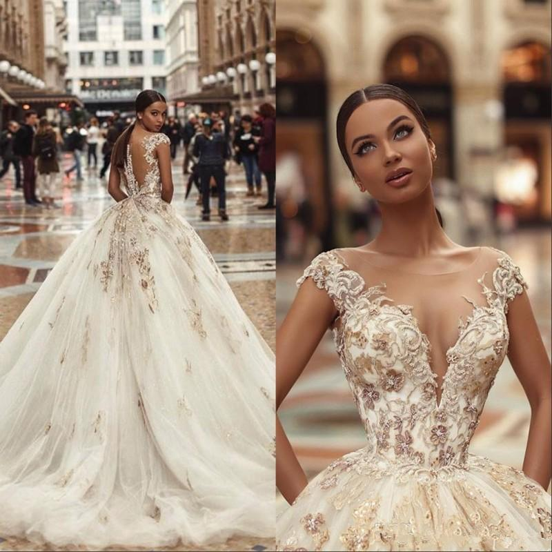 African Lace Bead Wedding Dresses Sheer Neck Illusion Capped Sleeves Mermaid Bridal Gowns With Back Covered Buttons vestidos de novia