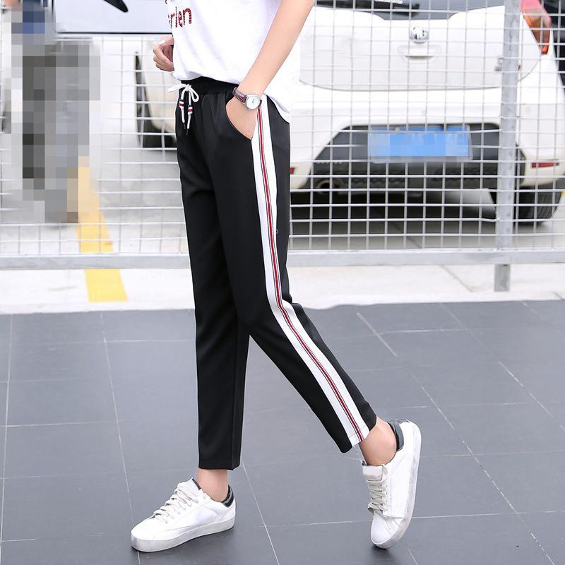 lado Harem de las mujeres jadean los pantalones a rayas negro blanco elástico flojo delgado pantalon mujer Femme fz2639