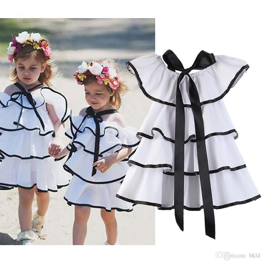 Лето Новейшего Kid Baby Girl платье черный белый с плечом Sundress партии торта Тута платья моды девочки Одежда платье 1-6T