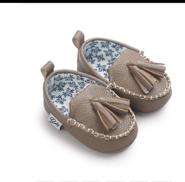Zapatos de moda los primeros caminante del bebé recién nacido la muchacha del bebé de la PU de la borla de los zapatos de cuero colgante