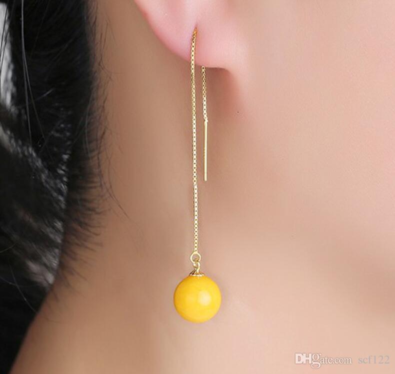 La cera de abejas pendientes mujeres línea de color ámbar oído largo de pollo aceite de color amarillo antiguos pendientes de cera de miel S925 antialérgico pendiente amarillo miel