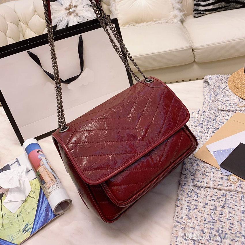 Top Quality women Vintage fold quilting oil cured cowhide postman Mini-Bag with one shoulder slanting V-pattern 28x21x15 cm