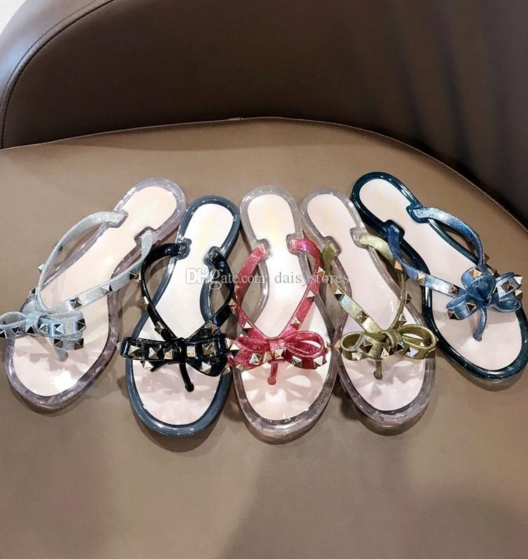 2019 European summer new fashion rivet bow flat flip flops women wear cool slippers jelly shoes size 35-40