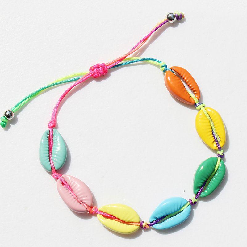 12pcs / lots Europe et Amérique Simple style réglable tressé main cadeau de mode bijoux en alliage de couleur Sandy beach Shell bracelets pour les femmes