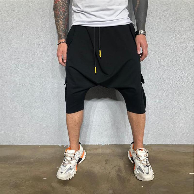 Harem flojo del ajustado de los hombres de color sólido causales de bolsillo Calf- Longitud pantalones casuales de color elástico elástico de la cintura Moda Fit VENTA CALIENTE