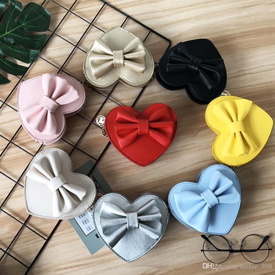 حقائب يد الأطفال أحدث الأزياء الكورية شكل قلب BOWKNOT عبر هيئة الطفل بنات الحلويات رسول حقائب عملة وحاملات حقائب سفر المراهقين