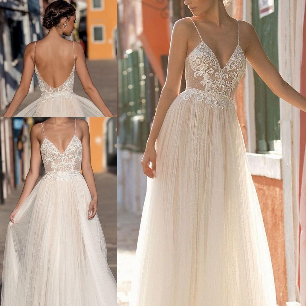 2020 Robes de mariée de plage Robes de mariée en dentelle Applique Bohême bretelles spaghetti encolure en V Backless étage longueur Custom Made Chic