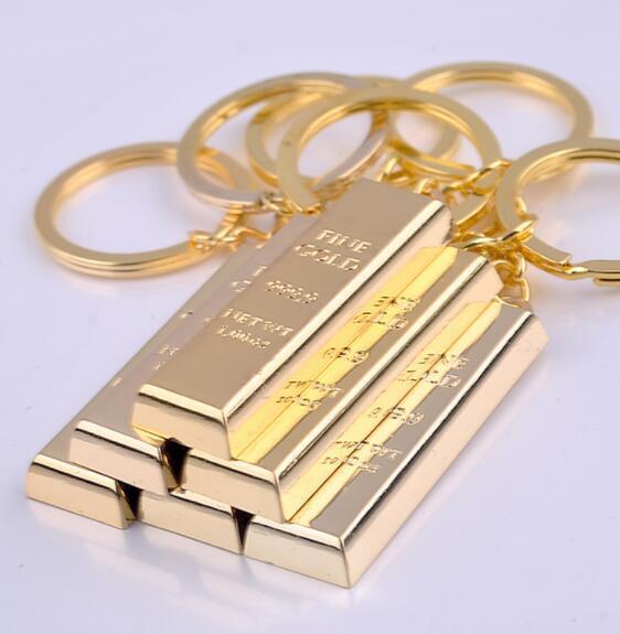 DHL الذهب سلسلة مفتاح سلاسل المفاتيح الذهبية أقراط سحر حقيبة قلادة مفتاح حلقات معدنية مفتاح مكتشف الفاخرة رجل سيارة التبعي الإقليم الشمالي