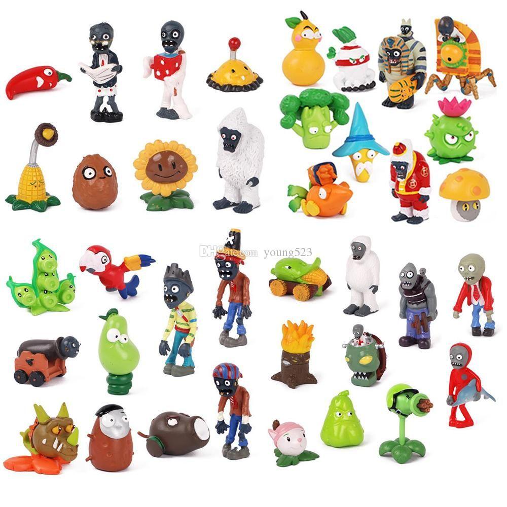 Mini PVZ Plants vs Zombies 2 juguete Figuras de acción de dibujos animados muñeca sólidas manos de PVC hacen los regalos de navidad muñeca de caída de los niños decoración del coche 3 ~ 8 cm