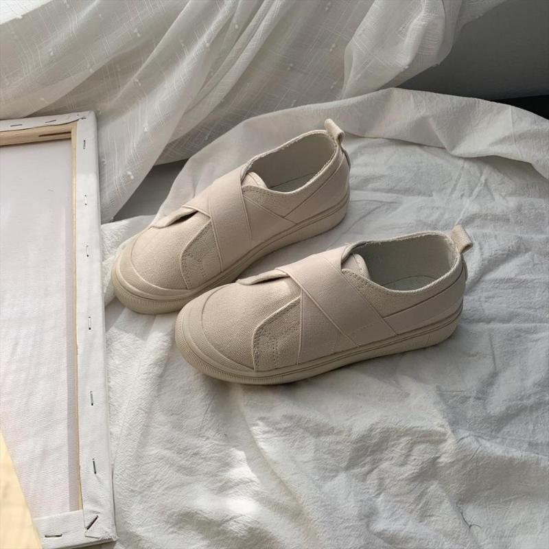 Segeltuchschuhe einfache Art und Weise bequeme flache Unterseite Frauen Casual Schuhe wilden College-Stil ein Pedal kleinen weißen Retro