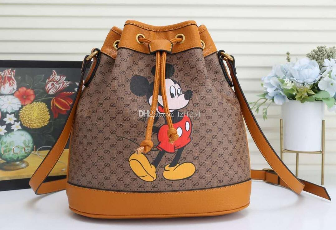 Ready stock shoulder bag 2020 Canvas with leather Cartoon print Women Bucket bag crossbody Cosmetic Bags 2691