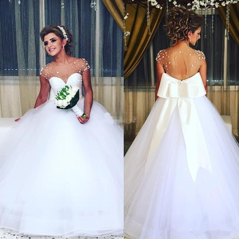 Beaded Beach Wedding Dresses With Bow Sheer Neck Capped Sleeves Sexy Back Wedding Gowns robe de mariee Tulle Cheap Bride Dress