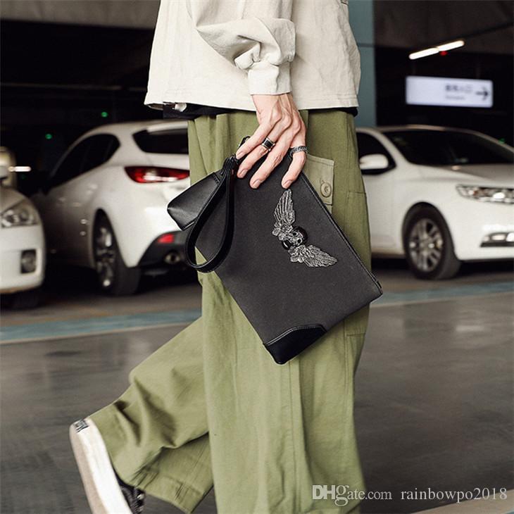 wholesale men handbag street trend metal ghost head men wrist bag personality skull men hand clutch multifunctional contrast leather envelop