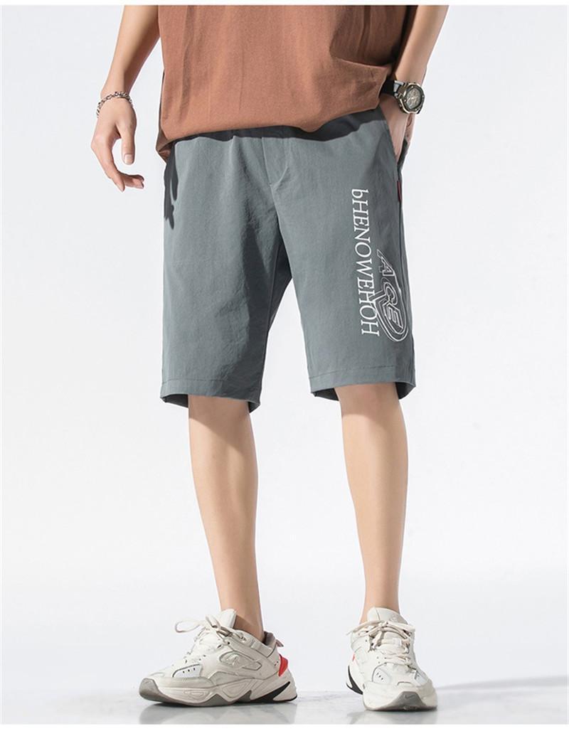 Longitud de la ropa deportiva con cordón flojo Pantalones cortos de bolsillo de ropa para hombre del diseño de impresión Carta pantalones del verano puro rodilla color