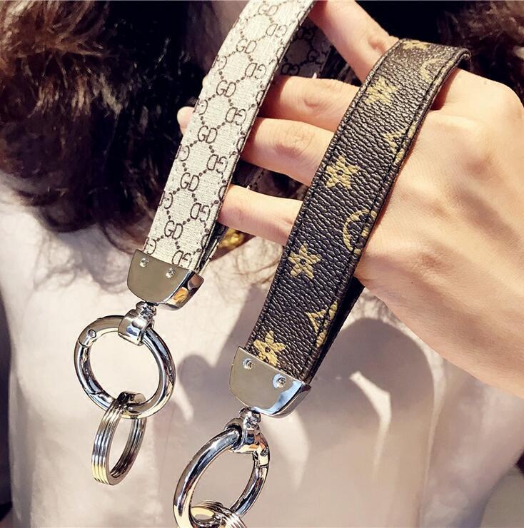 Hombres Mujeres clásico clave Diseñador Cadena Accesorios PU clave llavero anillo de coches anillos del encanto del regalo de la joyería clave