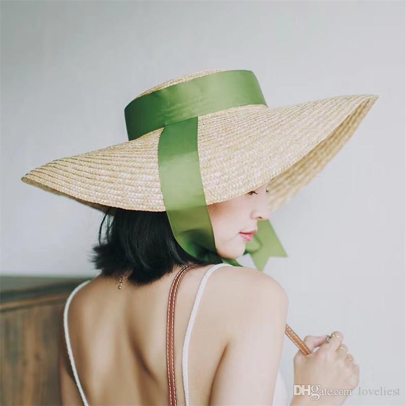 CAPPELLO nave! Designer gronda oversize donne elegante design di lusso del frumento-paglia Streamer arco cappelli di paglia piatte cappello della spiaggia del sole
