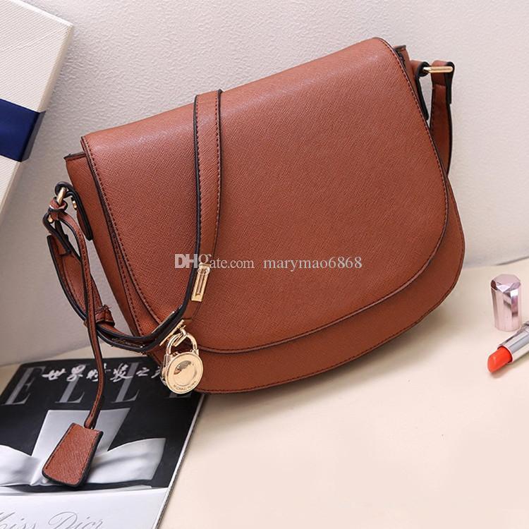 Nuevo Diseñador de moda Bolsos de hombro para mujer Bolso de cuero sintético con diseño cruzado Europa Mensajero de hombro Bolso pequeño con cerradura de silla de montar