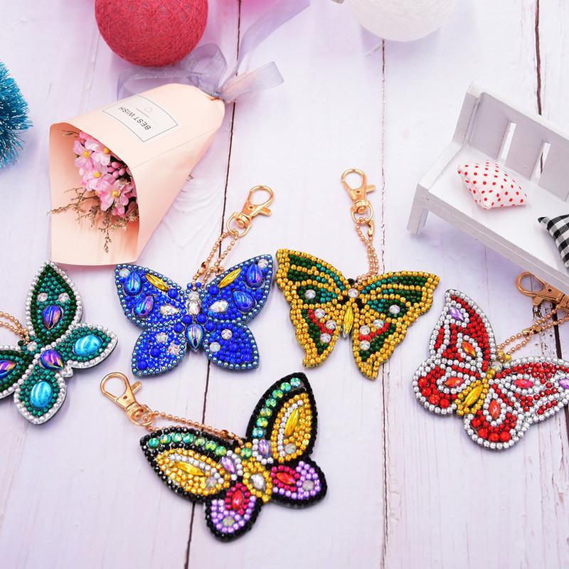 5pcs / lot DIY broca completa Rhinestone Keychain colorido da boneca do russo borboleta Fruit Amor Coração Pingente Chaveiro Mulheres Jóias Keyring