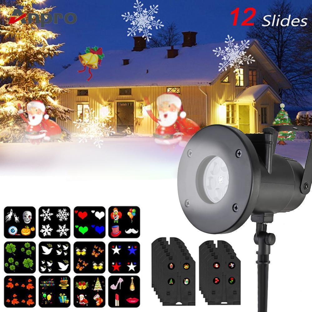 Feiertags-Dekoration Weihnachten LED-Rotating-Projektor-Lampe 12 Muster Auswechselbare Objektiv Innen / Außen-Gartenleuchte Weihnachtsbeleuchtung
